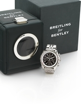BREITLING. A RARE HEAVY LIMITED EDITION OVERSIZED 18K WHITE GOLD OCTAGONAL AUTOMATIC PERPETUAL CALENDAR CHRONOGRAPH WRISTWATCH WITH SLIDE RULE, MOON PHASES AND BRACELET