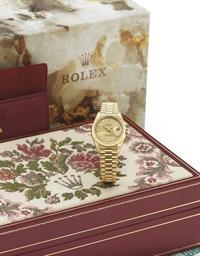 ROLEX. A LADY'S FINE 18K GOLD