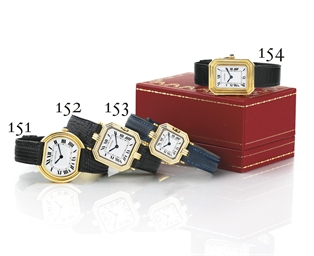 CARTIER. AN 18K GOLD TONNEAU W