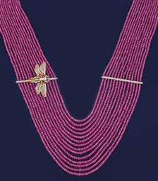 A pink sapphire, diamond and e
