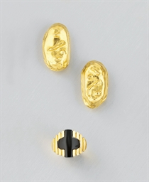 A pair of earclips, by Jean Ma