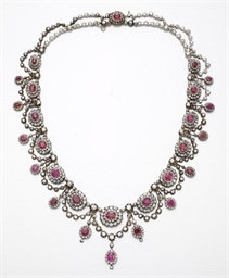 AN ANTIQUE RUBY AND DIAMOND NE