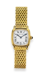 A GOLD WRISTWATCH, BY CARTIER