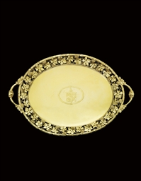 A GEORGE III SILVER-GILT TRAY