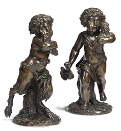 A PAIR OF BRONZE STATUES OF A