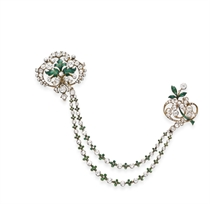 AN ANTIQUE DIAMOND AND ENAMEL CORSAGE BROOCH