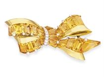 A RETRO CITRINE, DIAMOND AND GOLD BROOCH, BY OSCAR HEYMAN &