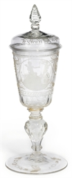 A CUT AND ENGRAVED GLASS GOBLE