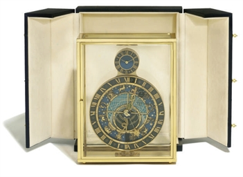 A gilt-brass desk timepiece wi