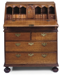 AN EARLY GEORGE III OAK BUREAU
