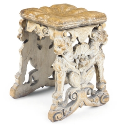 AN ITALIAN CARVED PINE STOOL