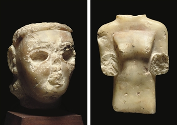 A SOUTH ARABIAN ALABASTER FEMA