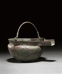 A NEAR EASTERN BRONZE STRAINER