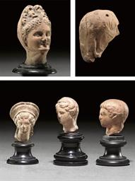 A GREEK TERRACOTTA HEAD OF A V