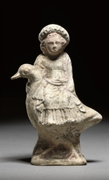 A GREEK TERRACOTTA STATUETTE O