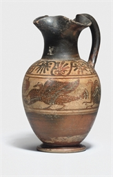 AN ETRUSCAN BLACK-FIGURE OINOC