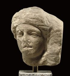 A ROMAN MARBLE FEMALE RELIEF H