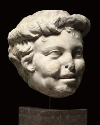 A ROMAN MARBLE HEAD OF A SATYR
