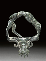 A ROMAN BRONZE VESSEL HANDLE