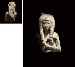 AN EGYPTIAN LIMESTONE BUST OF