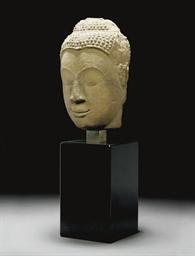 A STONE BUDDHA HEAD, THAILAND,