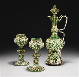 A BOHEMIAN GREEN GLASS EWER AN