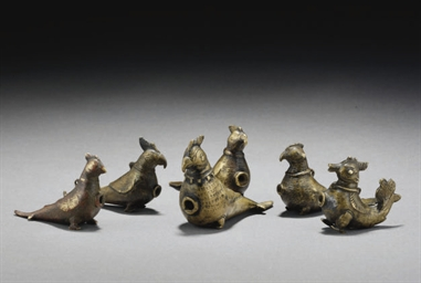 A GROUP OF SIX BRONZE BIRD-SHA