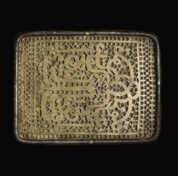 AN OPENWORK BRASS BUCKLE, NORT