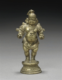 A GILT BRONZE MODEL OF KRISHNA