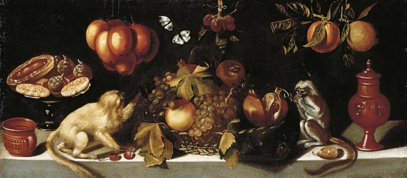 Grapes and pomegranates in a w