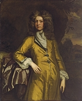 Portrait of a gentleman, traditionally identified as Sir Bulstrode Whitelock (1605-1675), three-quarter-length, in a yellow coat, against a rocky outcrop, a landscape beyond