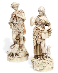 A PAIR OF ROYAL DUX FIGURES OF