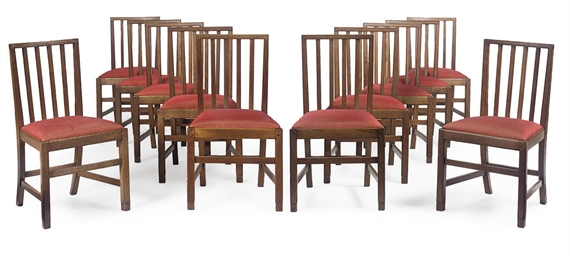 A SET OF TWELVE OAK DINING CHA