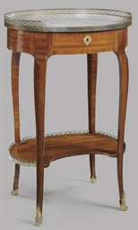A LATE LOUIS XV TULIPWOOD TABL