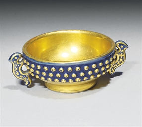 A SMALL GILT AND BLUE-ENAMELLE