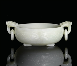 A FINE WHITE JADE MARRIAGE BOW