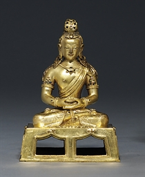 A GILT BRONZE MODEL OF A AMITA