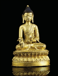 A GILT-BRONZE FIGURE OF BHAISA