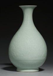 A FINELY CARVED CELADON-GLAZED