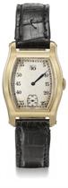 Meylan. An unusual 18K gold tonneau-shaped jump hour wristwatch