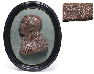 A PORPHYRY RELIEF BUST OF THE