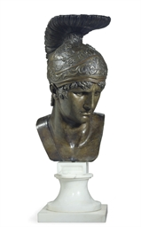A BRONZE BUST OF A MALE WARRIO