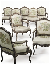 A SET OF EIGHT LOUIS XV SILVERED FAUTEUILS
