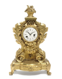 A LOUIS XV ORMOLU MANTEL CLOCK