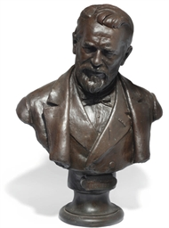 AN ITALIAN BRONZE BUST OF A GE