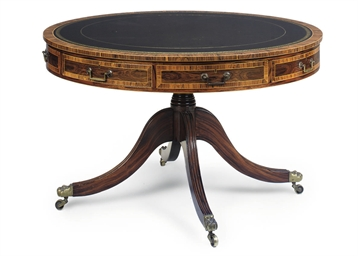 A ROSEWOOD DRUM TABLE