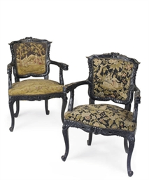 A PAIR OF FRENCH EBONISED ARMC