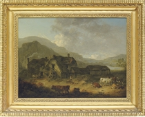 Mountainous landscape with a farm and cattle