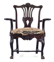 AN IRISH MAHOGANY OPEN ARMCHAIR