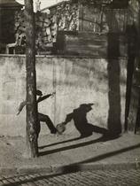 Child kicking ball, c.1930
